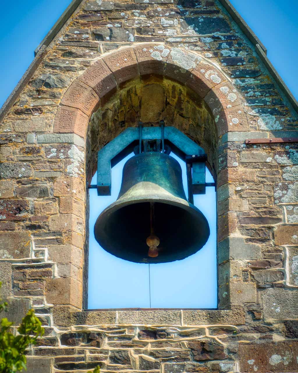 The bellcote of Virginstowe St Brigid's in Devon; unusually it does not have a tower, just this bell surrounded by gorgeous stonework.