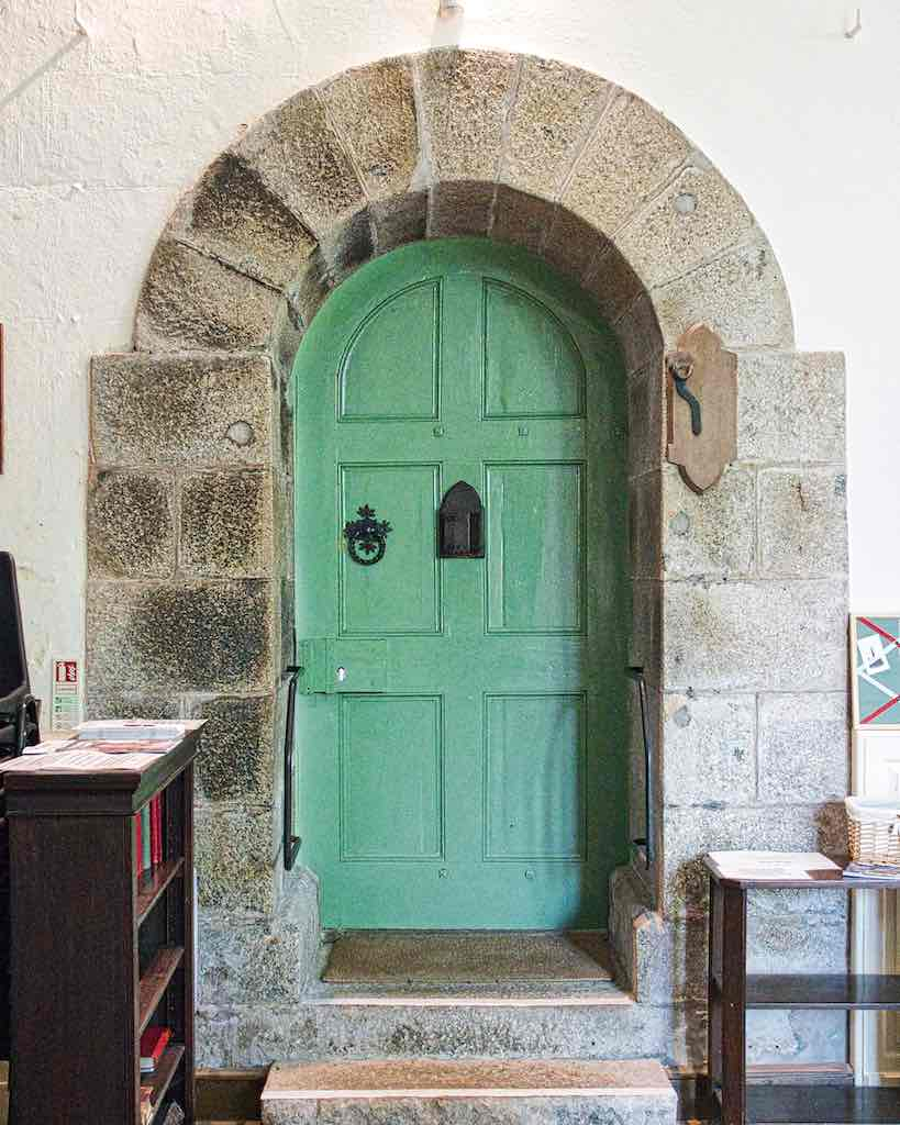 The fine old granite arch with a very domestic looking door.