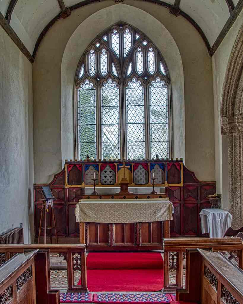 Peace in the Broadwoodwidger chancel, with a unique altar back.