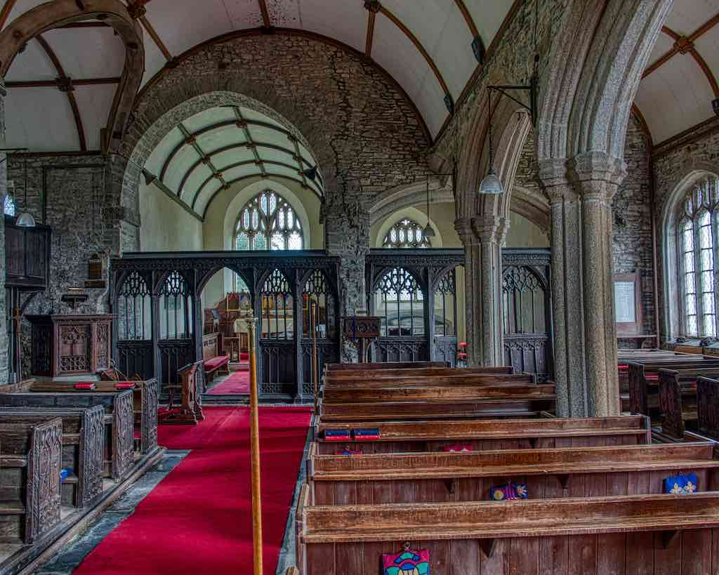 Interior of Broadwoodwidger church, showing the C13 chancel and nave, C14 south chapel, and C15/16 south aisle.