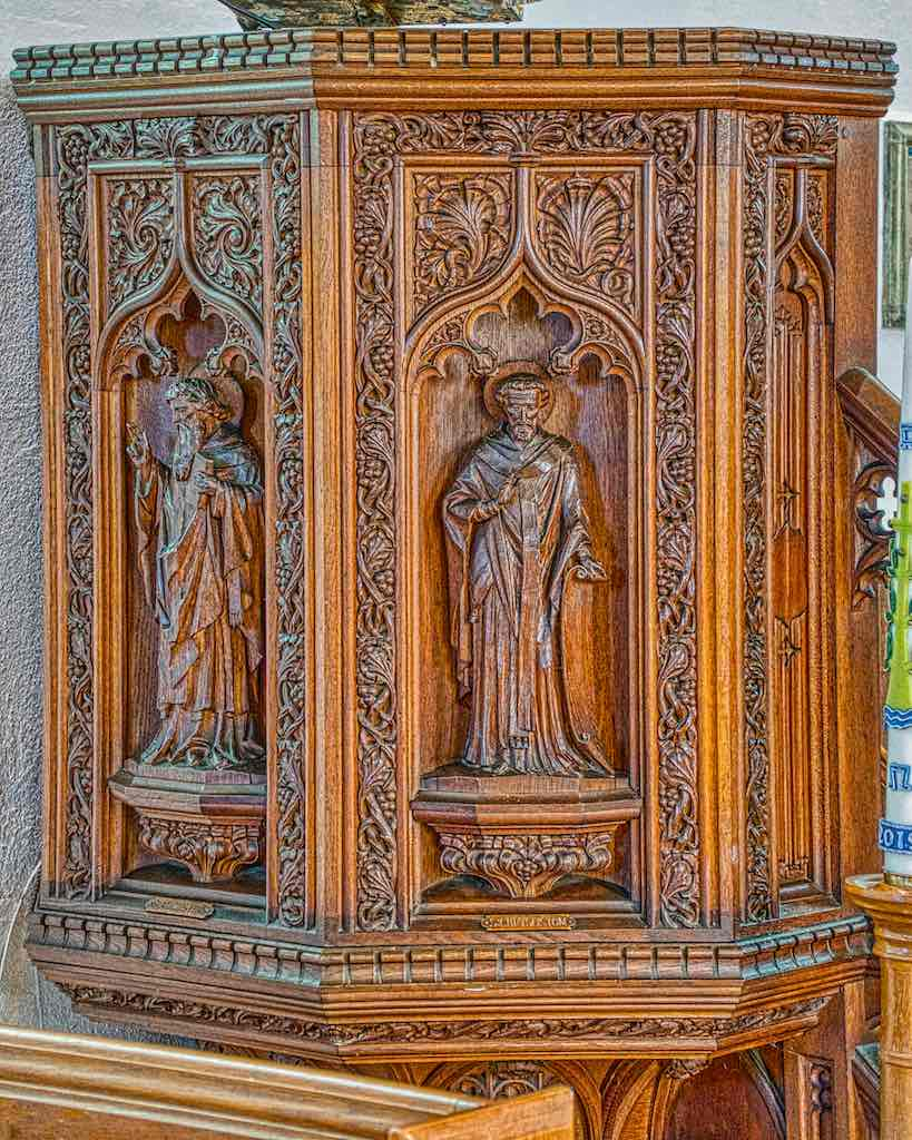 Intricate and delightful foliage carving on the early 20th century pulpit