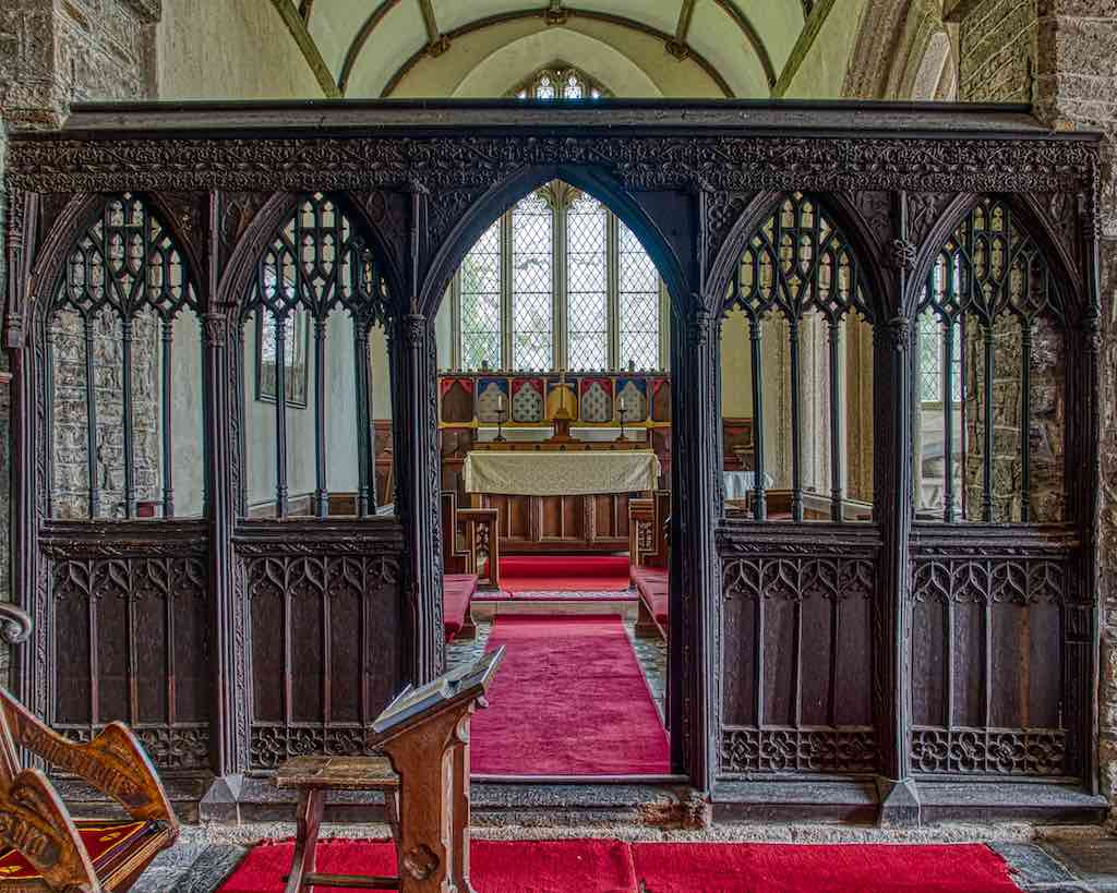 The 16th century roodscreen at Broadwoodwidger church, very simple for its time.