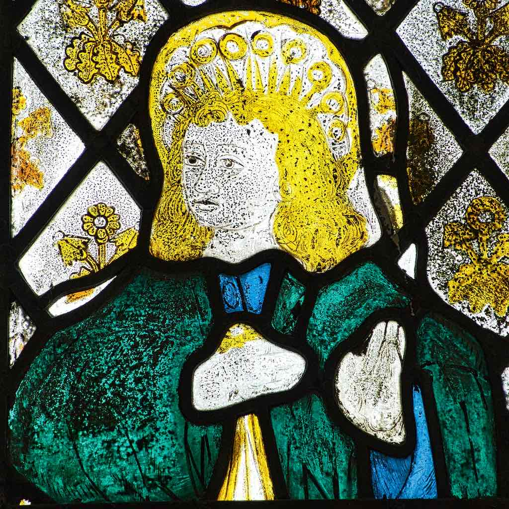 Probably St John the Evangelist in this faded piece of medieval glass; a face full of meaning.