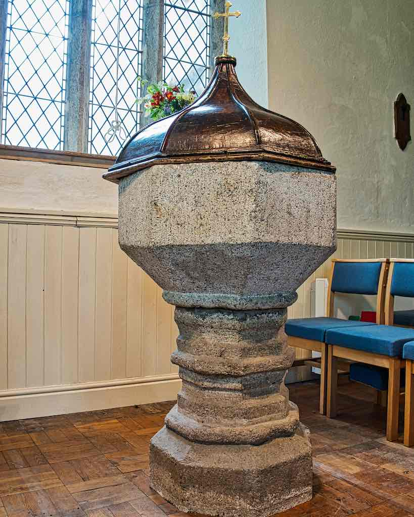 The 15th century granite font with 17th century font cover, a beautiful combination.