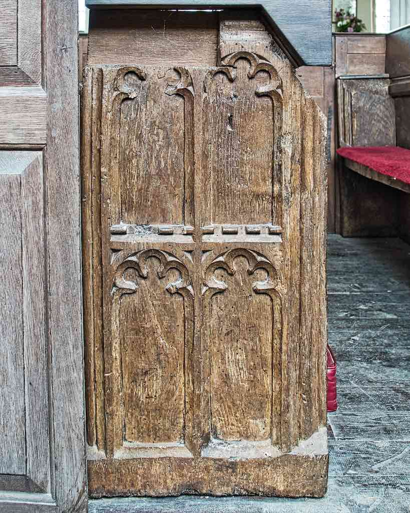 The older 16th century pews are hidden under the more recent ones.