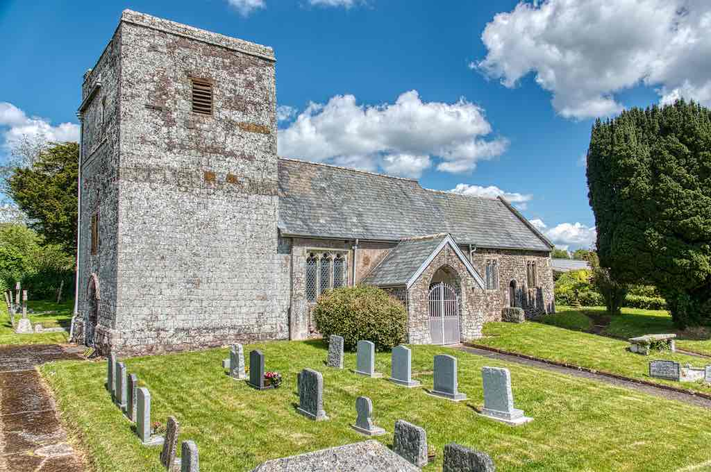 Loxbeare Church, beautifully situated with views south and an oh-so-neat churchyard.