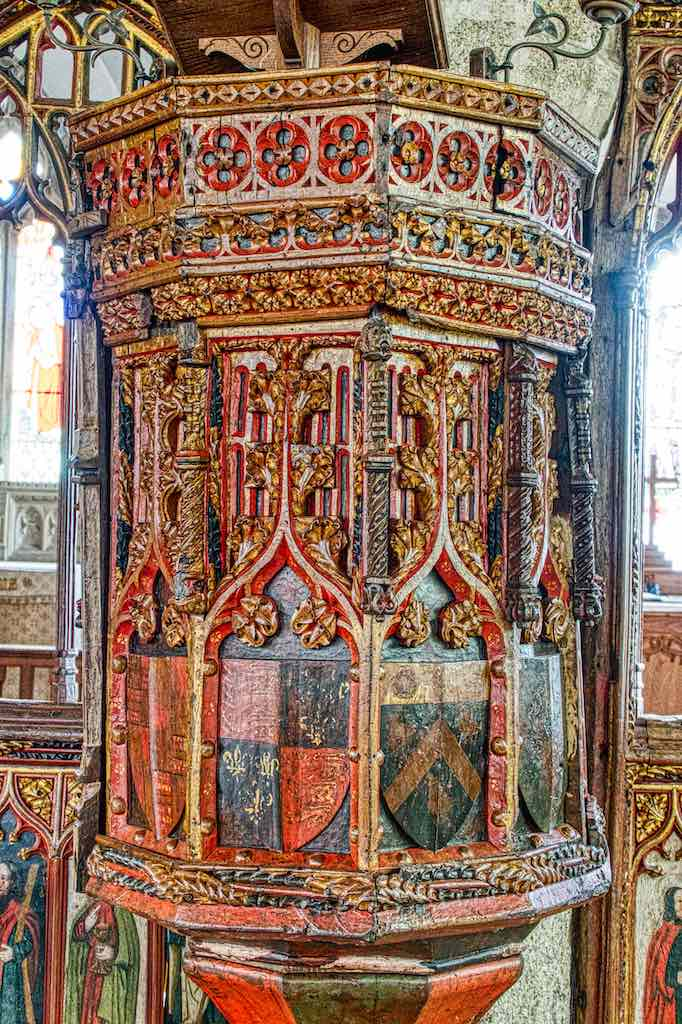 Such a magnificent combination of medieval carving and colouring, shapes glittering and gleaming, a jewel box for the words of the priest.