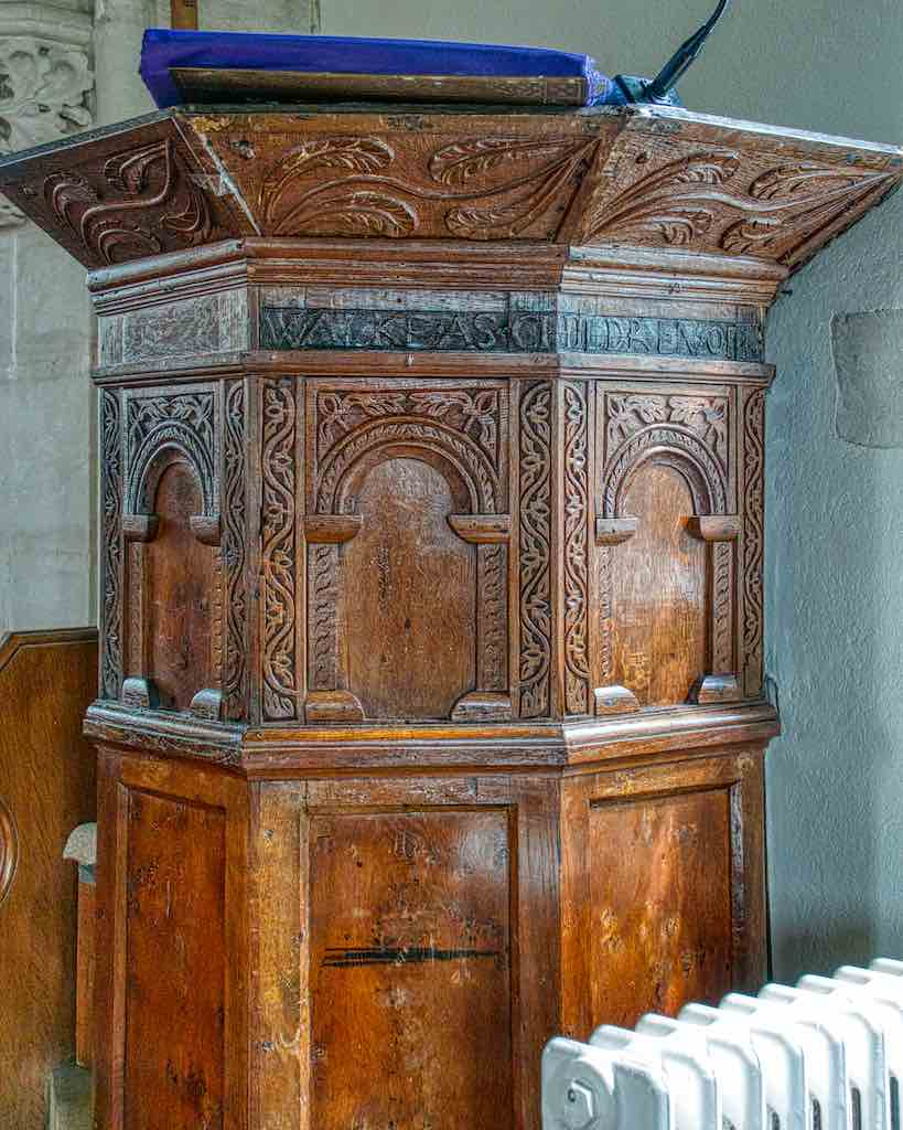 A well carved 17th century oak pulpit.