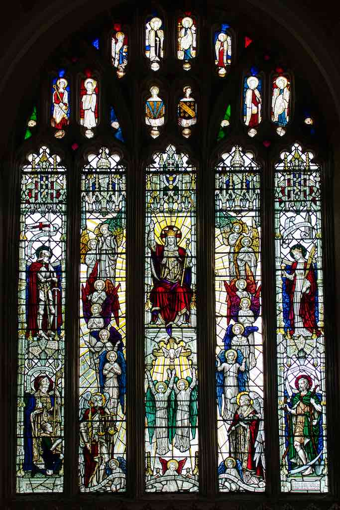 Marvellous stained glass from the 1930s has been placed below the medieval saints.