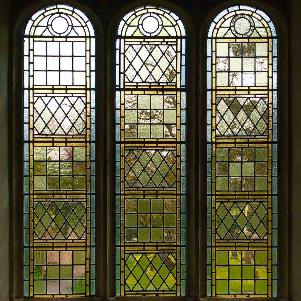Greens and golds and greys and fine glazing in this marvellous window in Dalwood.