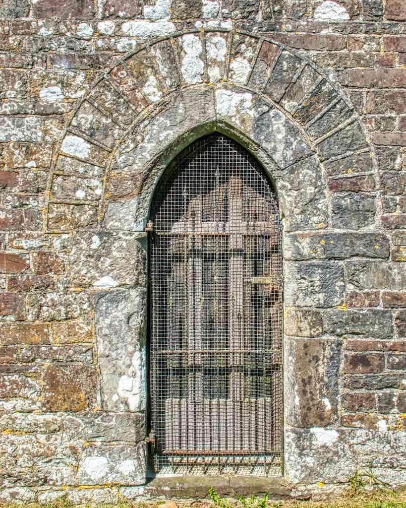 The old priest's door leading directly into the chancel, with some fine stonework surrounding it.