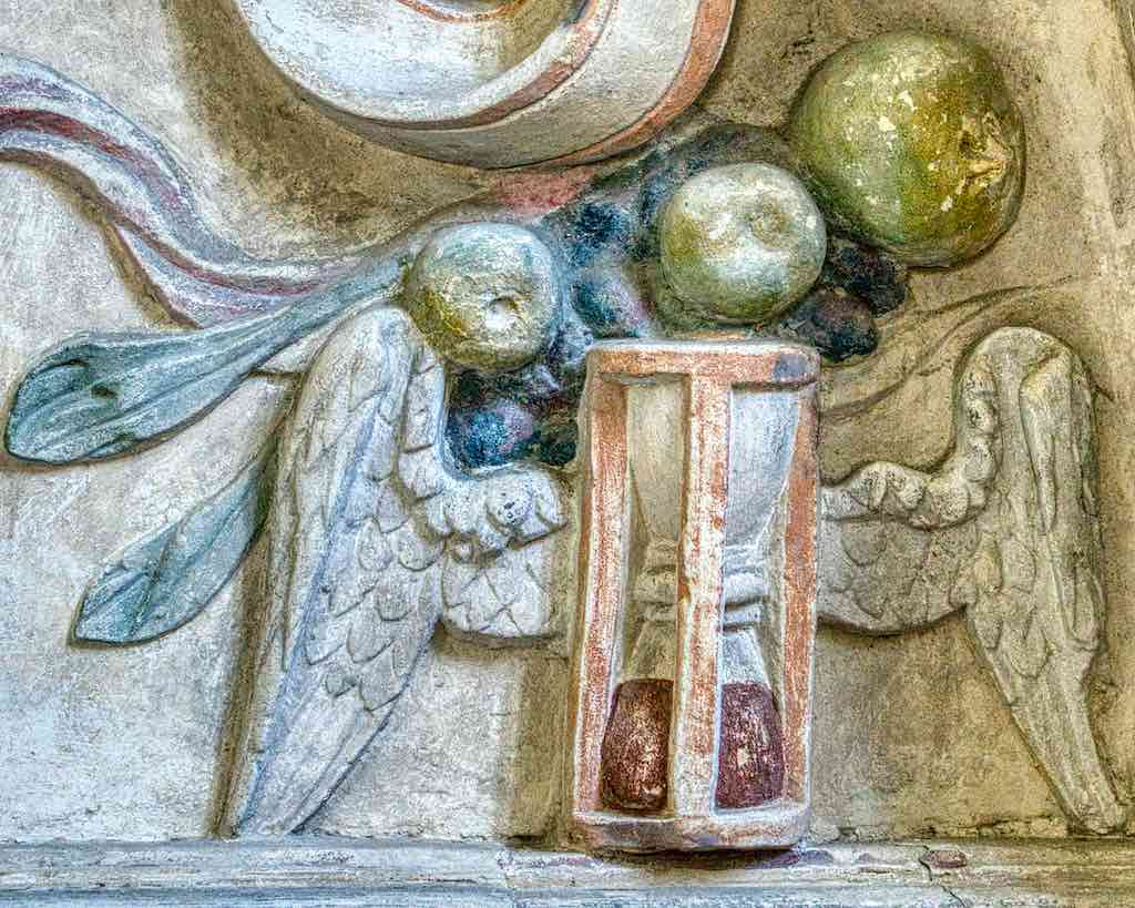 Detail from the Richard Cole monument, some fruit and a winged hour glass.