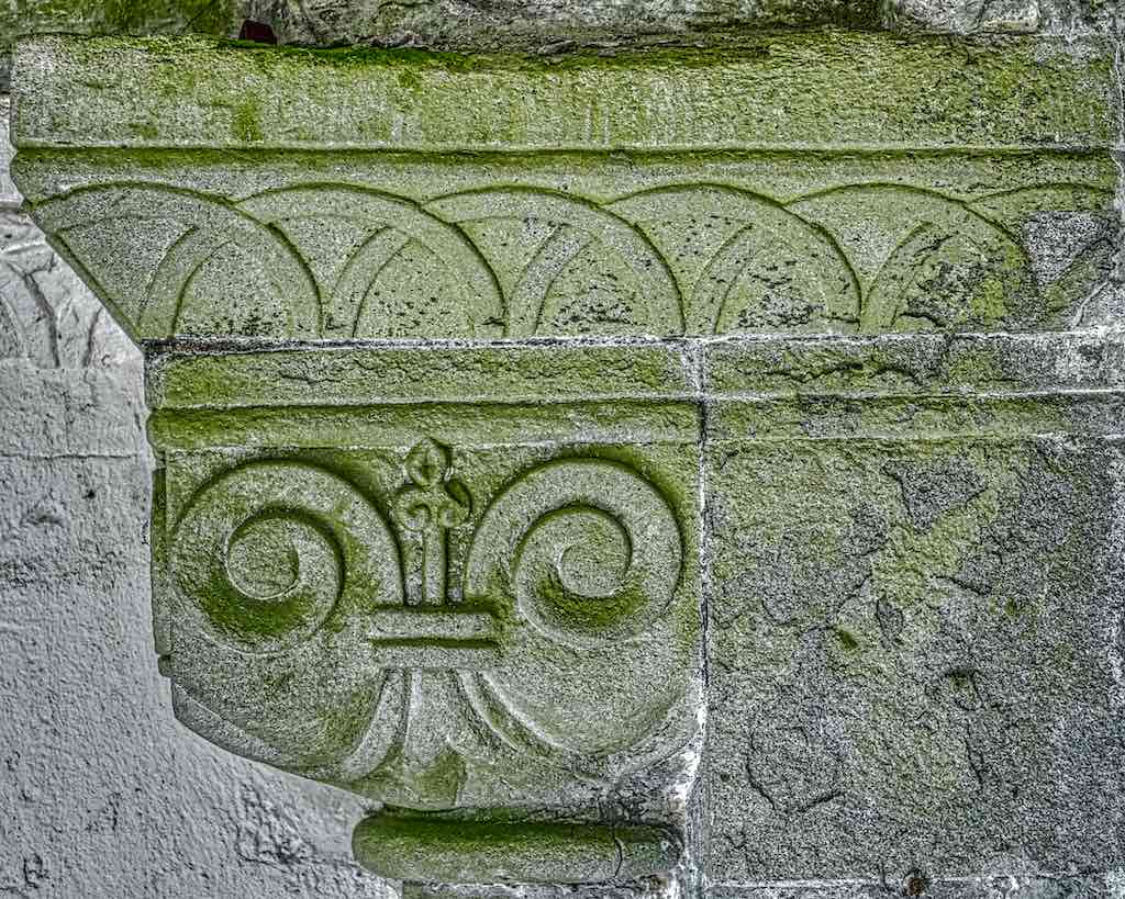 A finely carved Norman capital perfectly complements the carvings above it.