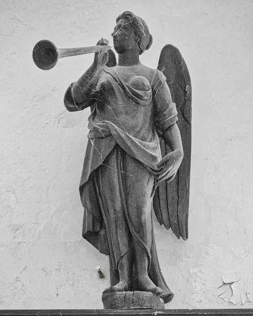 A fine 18th century angel trumpeting the good news.