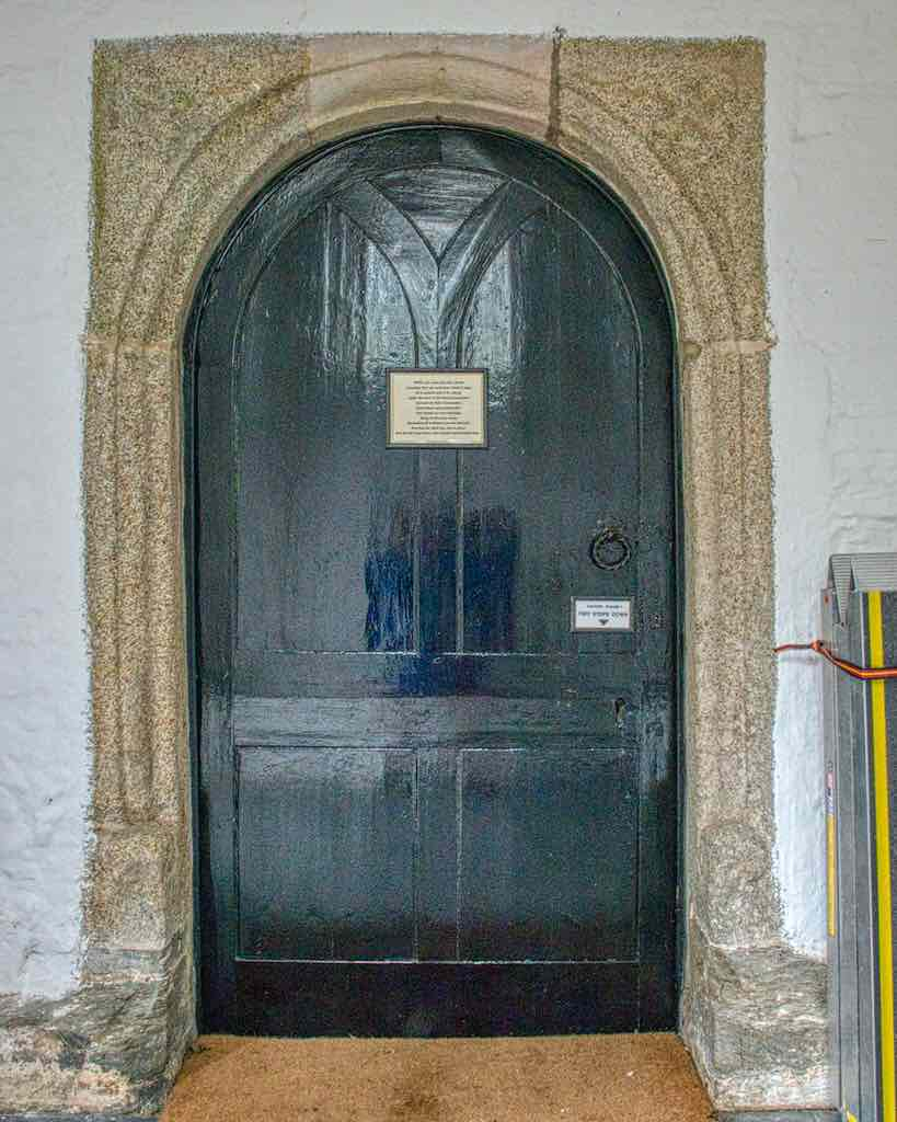The old south door now protected by a later porch. The actual door is early 19th century.