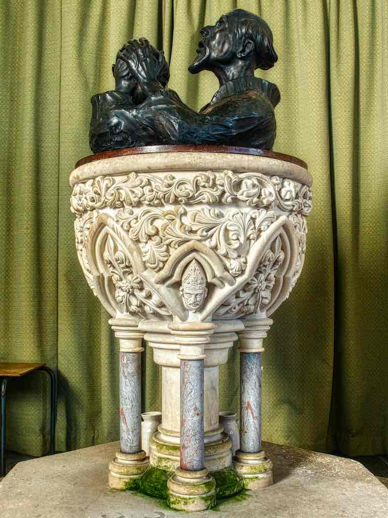 A fine Victorian font with a stunning sculpture as a cover