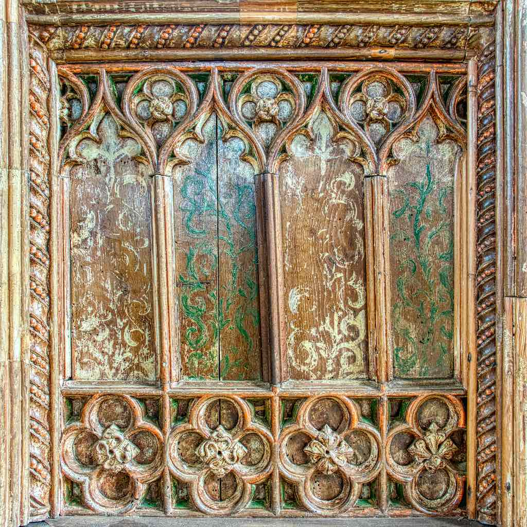 Beautiful coloured carved wood, with the panel painting from maybe a hundred years later.