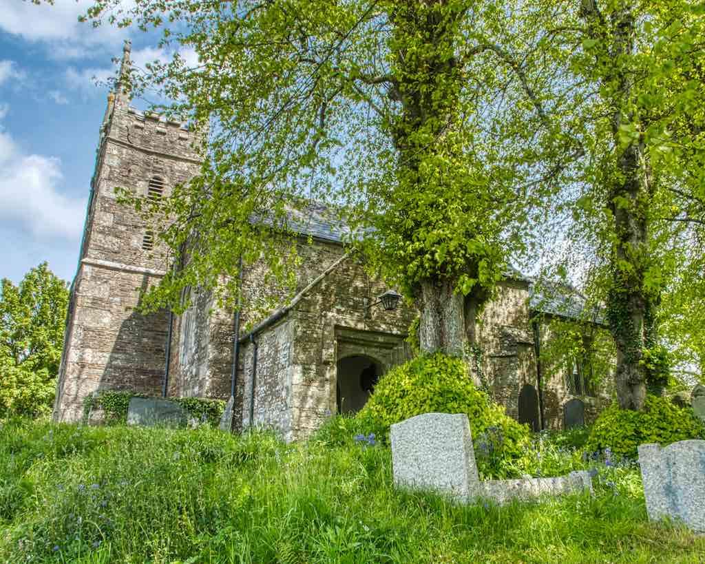 The granite church living amongst the trees.