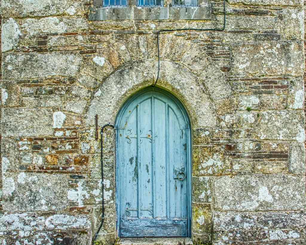 The west door with its fine country stonework and beautiful muted colours.