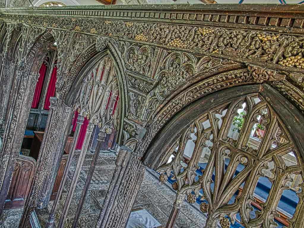 The rood screen covered in old carvings.