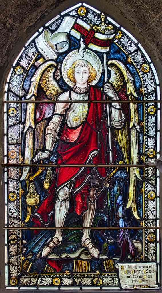 St Michael with a gleaming dragon at his feet.