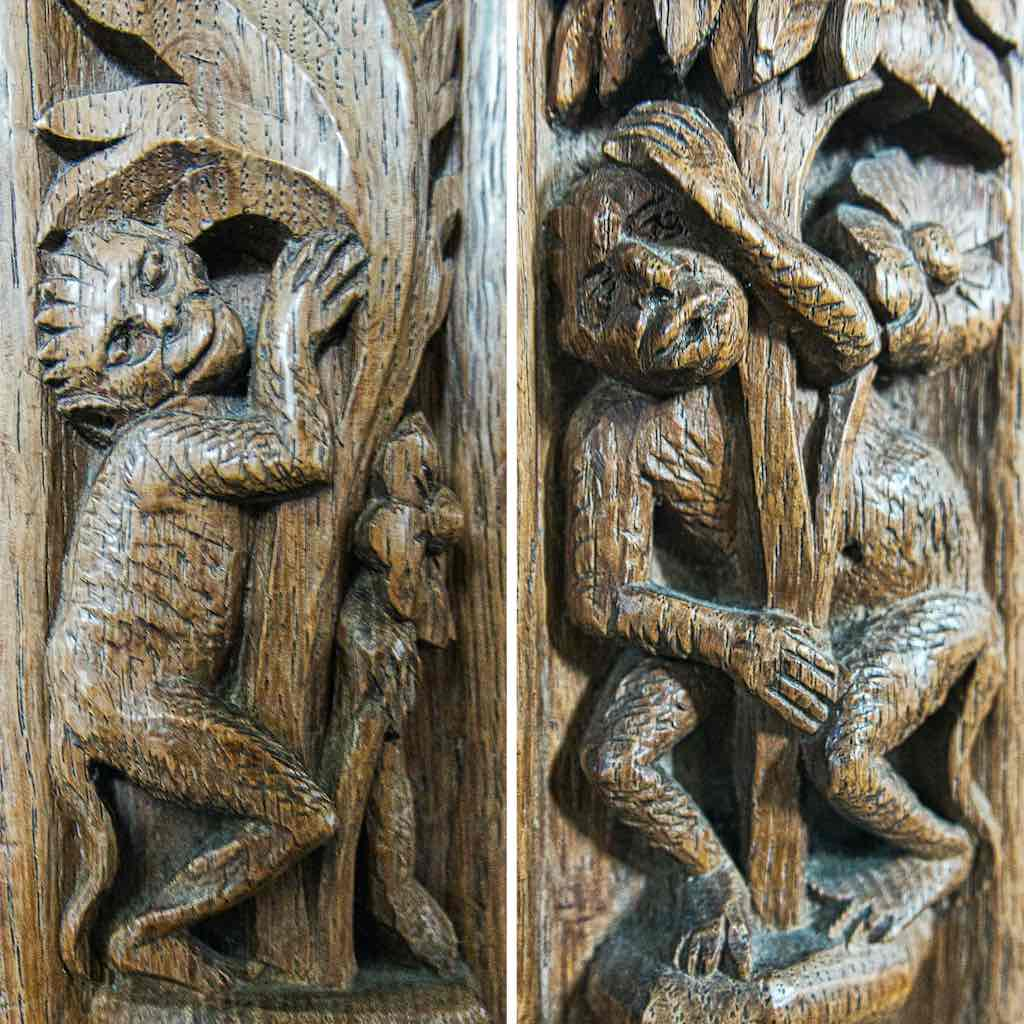 Delightful monkeys playing in the bench ends
