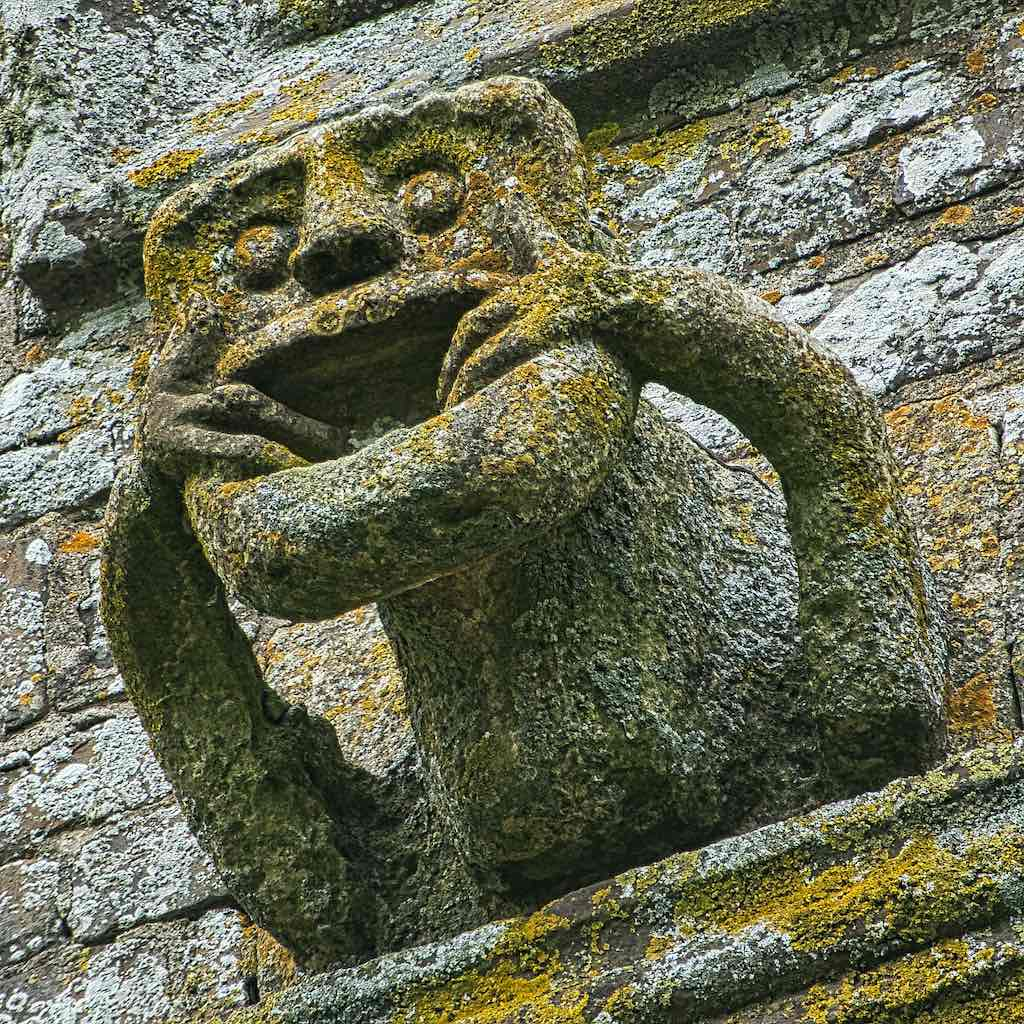 A grotesque, or a babewyn as they were called, of the mouth-puller variety.