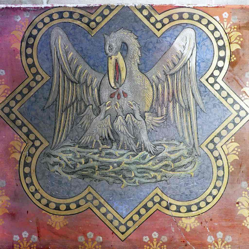 A Victorian Pelican in her Piety showing the pelican feeding her or his chicks with their own blood; Exeter, Wynards Chapel.