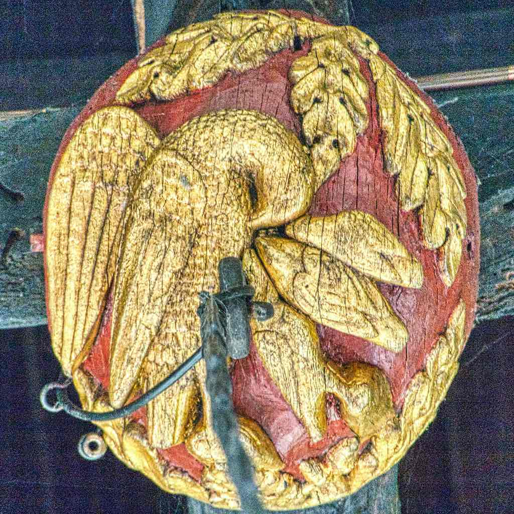 A 15th century roof boss showing a pelican and chicks from Braunton Church, North Devon.