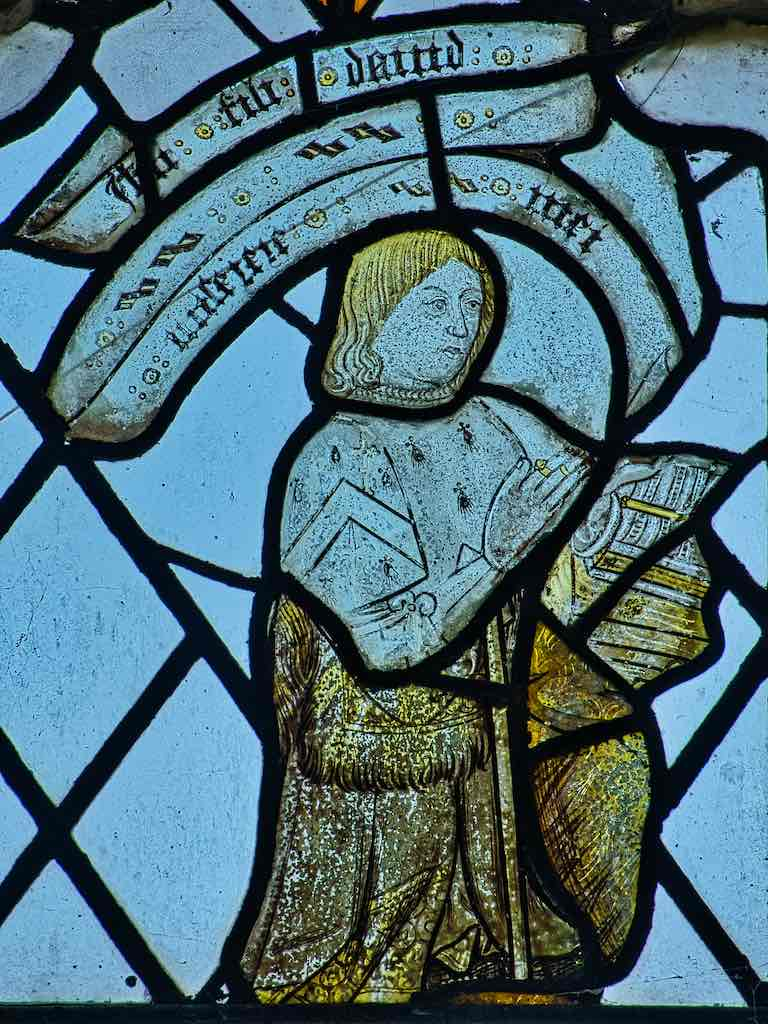 Medieval stained glass showing the probably donor of the window or the church.