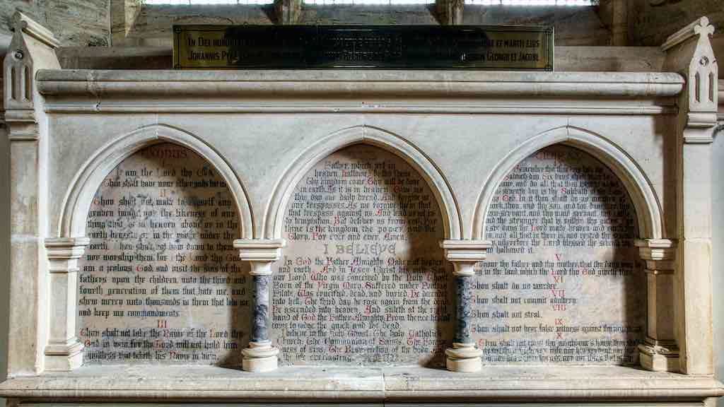 The altar back (reredos) with the Ten Commandments, the Lord's Prayer and the Credo.
