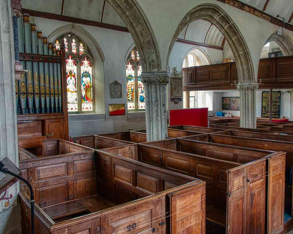 Delicious 18th century box pews fitted around the medieval stone