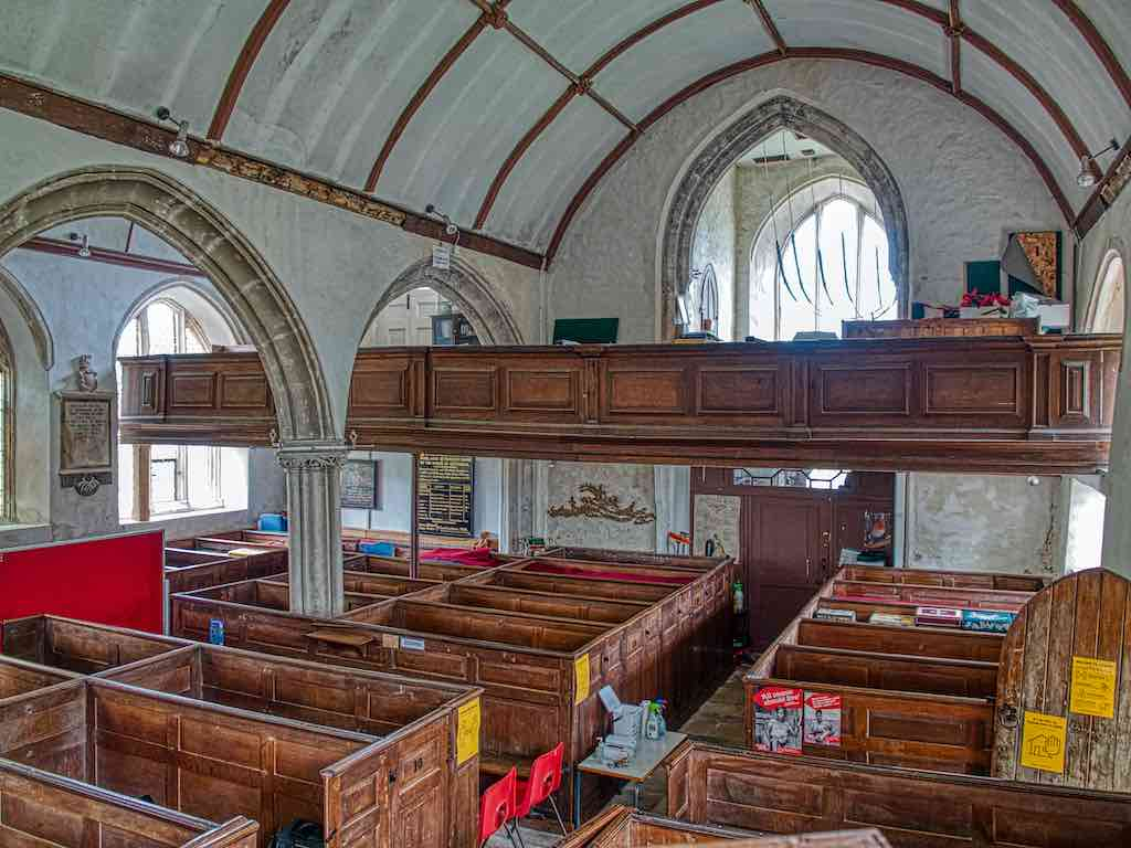 The 17th century west galley seems to float over the pews