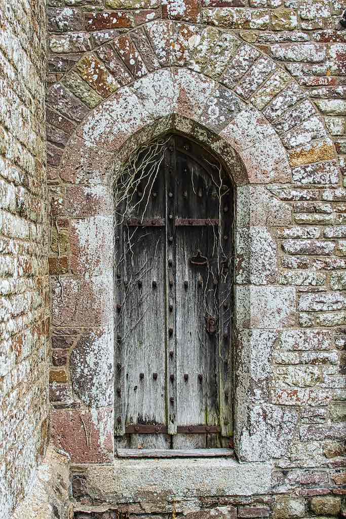 The priest's door set in powerful stonework.
