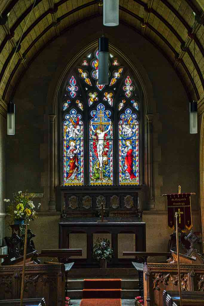 Deep shadow and glowing colours in the chancel.