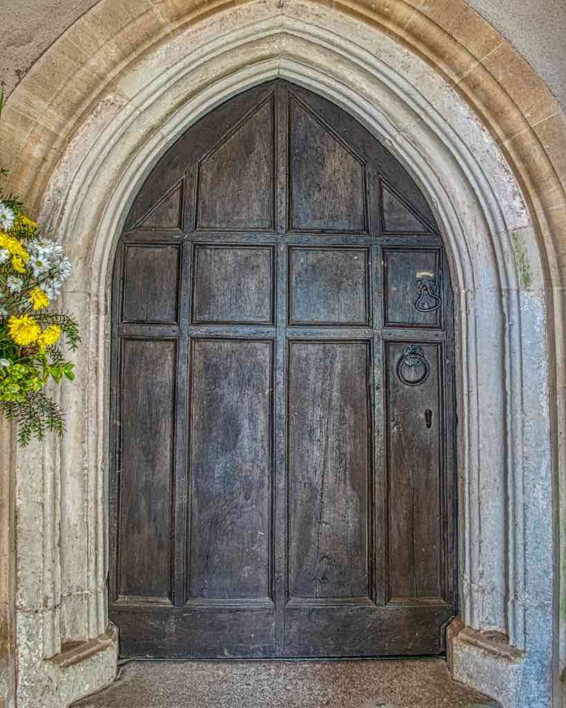 A 17th century door in a 15th century doorway surrounded by a 19th century one.