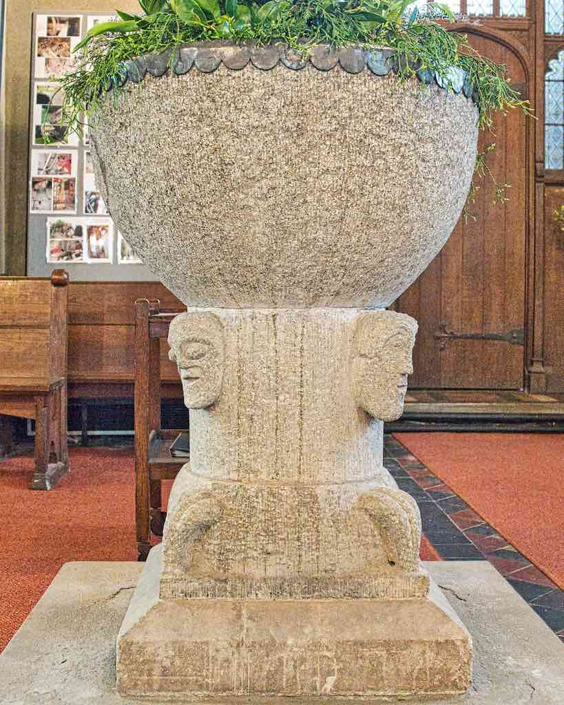 A Norman font with heads.