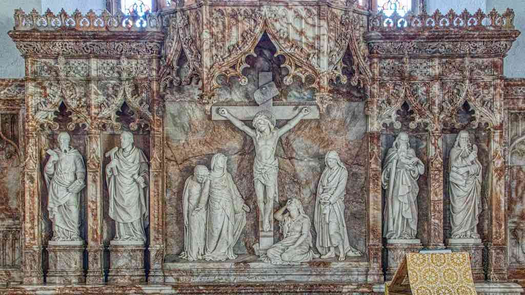 The Victorian alabaster altar back, technically called a 'reredos'