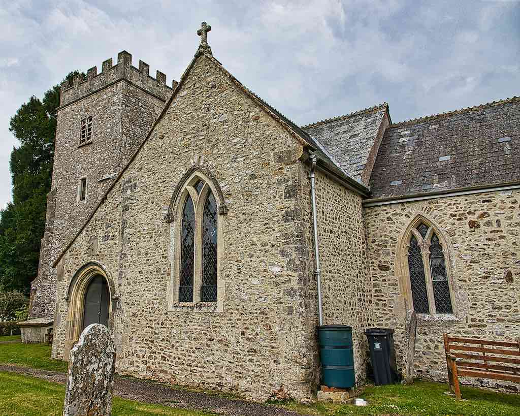 Widworthy Church of St Cuthbert with its flint and rubble exterior