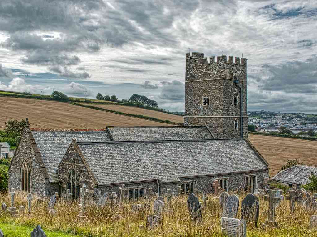 Instow Church of St John the Baptist sits where the Rivers Taw and Torridge meet, near their final exit to the sea
