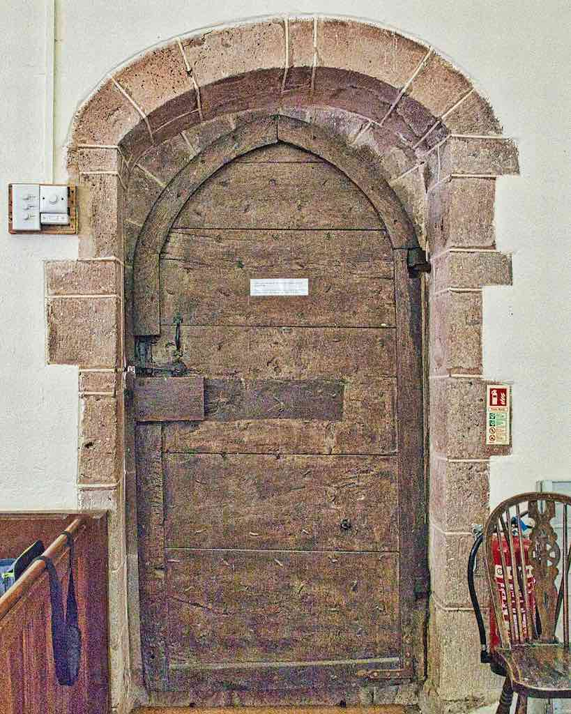 The stonework is Victorian renovation, the door is 17th century