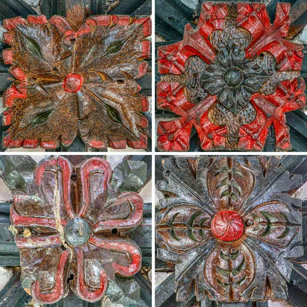 Roof bosses with original colouring in the chancel