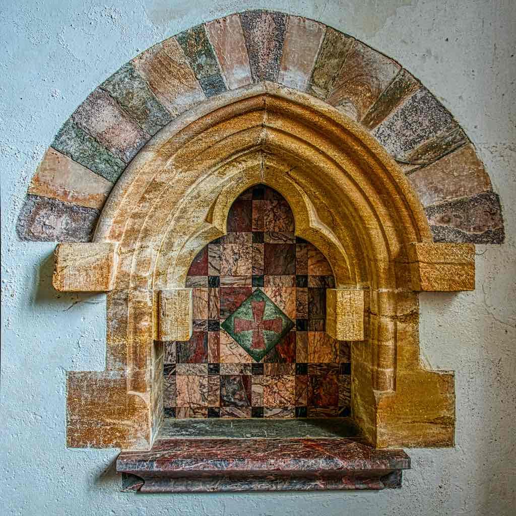Devon Marble, Ham Stone, Cornish Serpentine and good design make for a striking aumbry