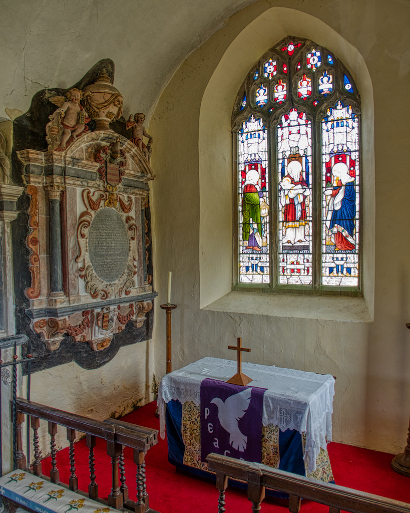 The 17th century memorial overshadowing the altar