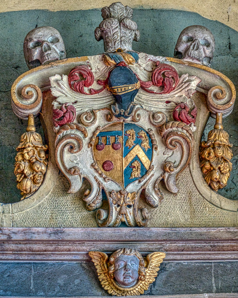 The beautifully detailed coat of arms on the Courtenay memorial