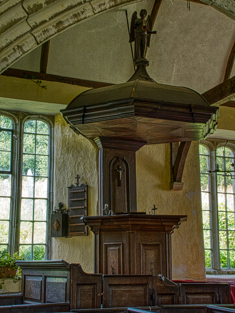 The three-decker pulpit with sounding board and trumpeting angel on top