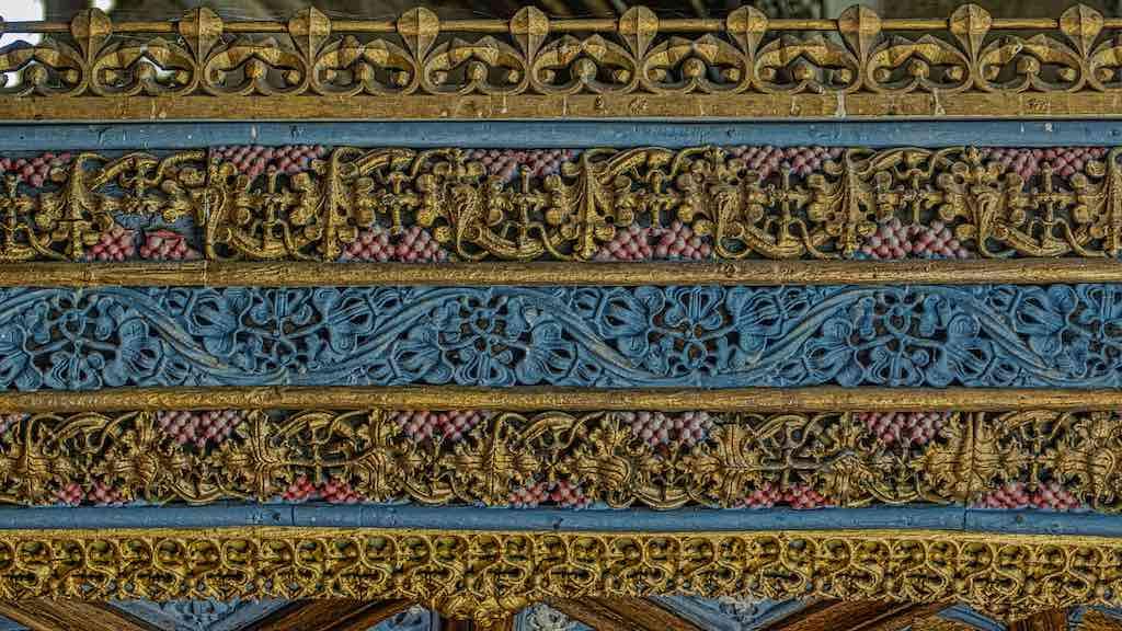 The intricate rood screen cornice