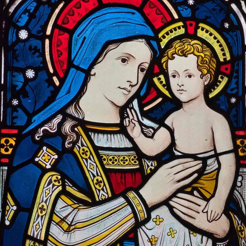 A striking Madonna and Child in stained glass inside Hemyock church