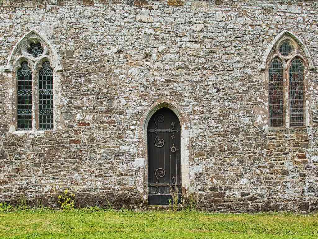The 14th century priest's door and windows