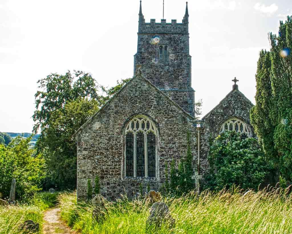 A narrow path leads through a pretty churchyard